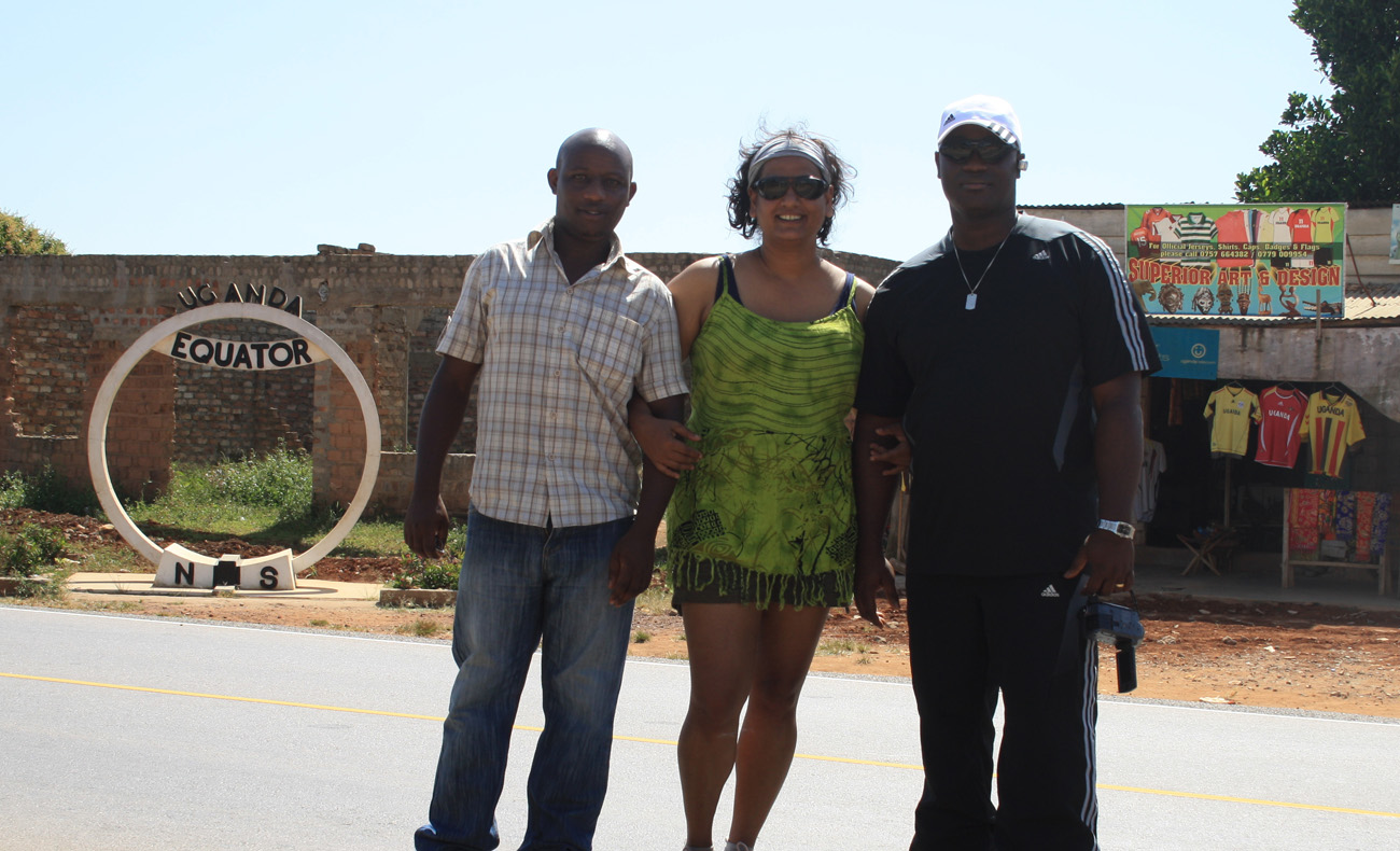 At  the Uganda Equator - on my left is George, a UNPOL officer from Sudan.